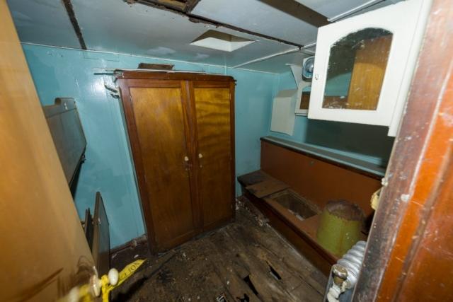 Water Damaged Seaman's Cabin Due to Leaking Decklights